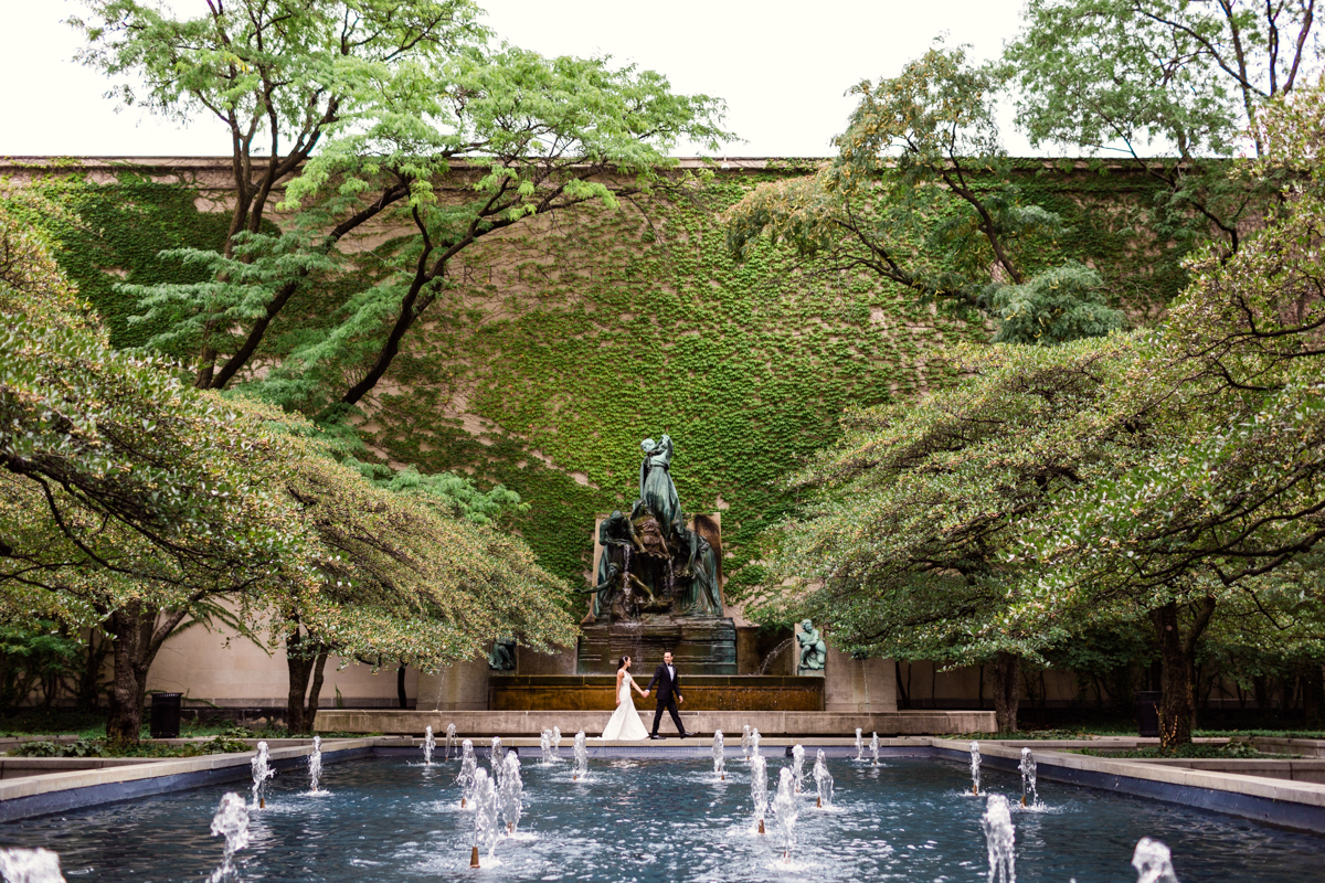 Art Institute of Chicago wedding photo of bride and groom by documentary wedding photographer Emma Mullins Photography