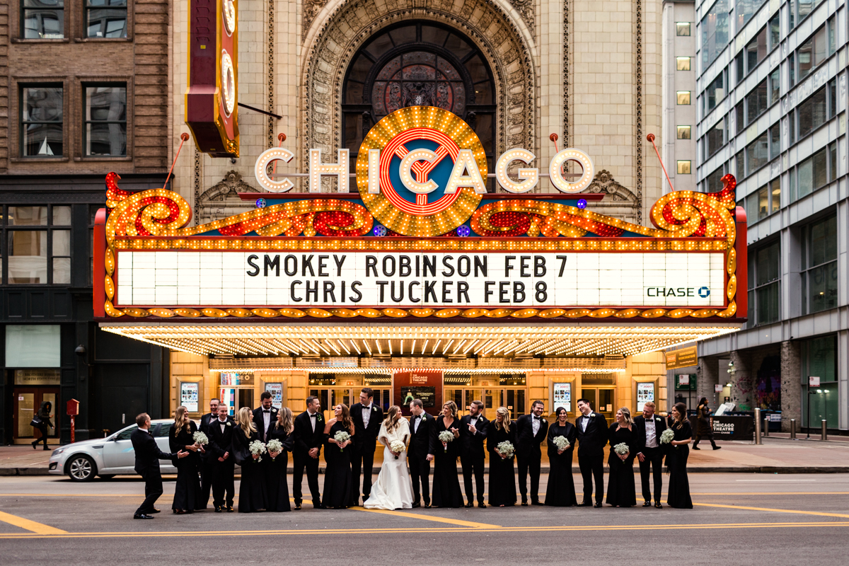 Chicago Theatre wedding party photo on State Street by documentary wedding photographer Emma Mullins Photography