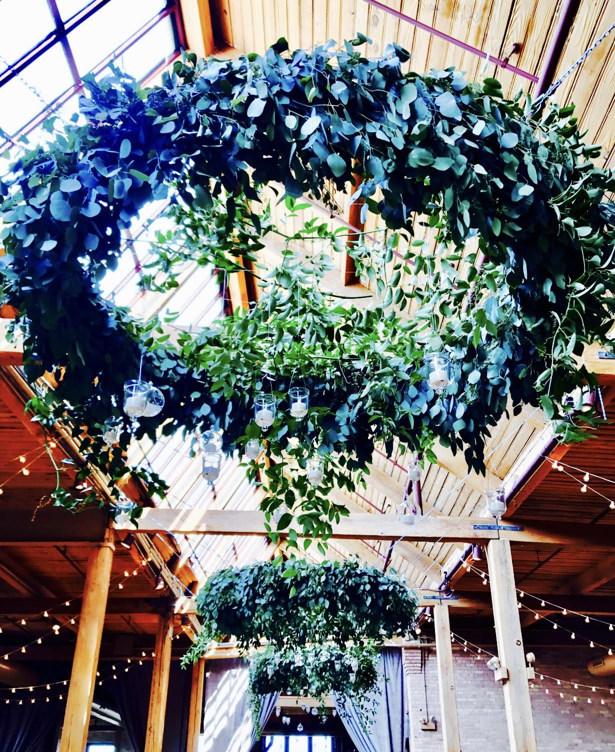 Beautiful hanging fresh greenery Halos with candle votives