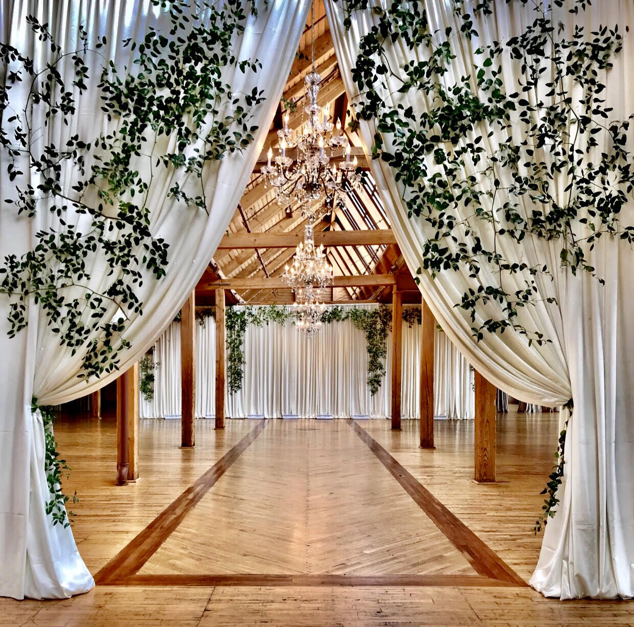 Full entrance drapery + wider backdrop with greenery