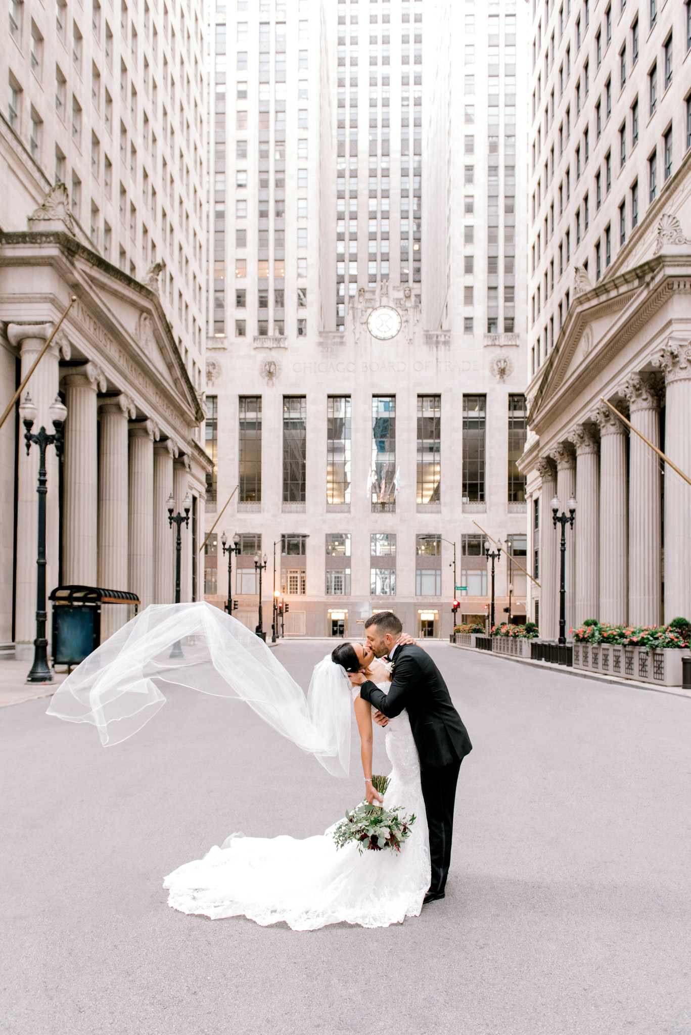 bride and groom portrait by board of trade