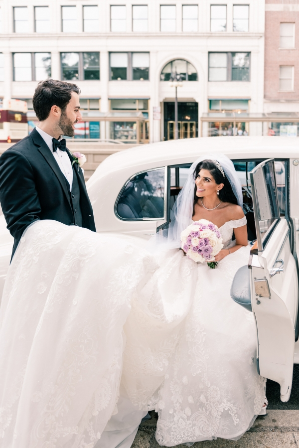 bride and groom with rolls royce