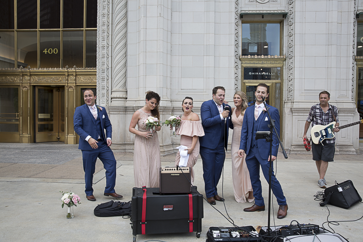 The Wedding Party Takes in Some Street Karaoke During Our Photo Session