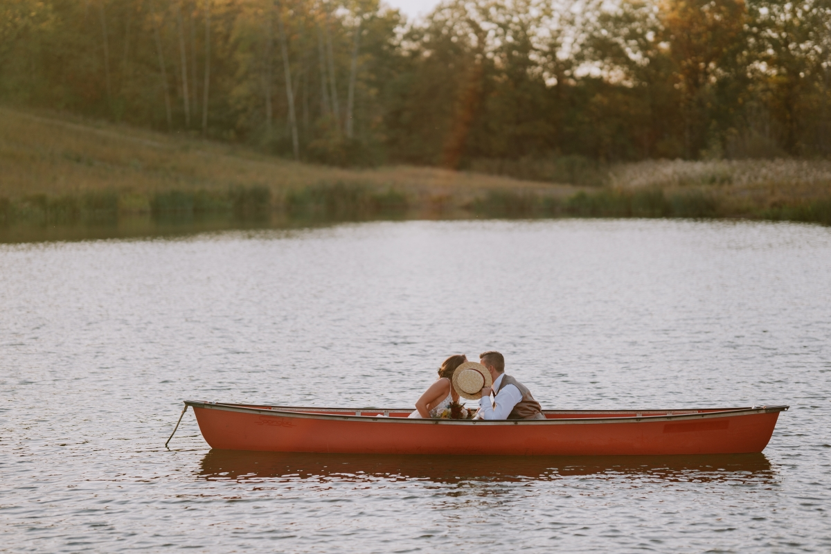 Millennium Moments Chicago Wedding Photographer Camp Aramoni Tonica Illinois boat kiss cute rustic 1